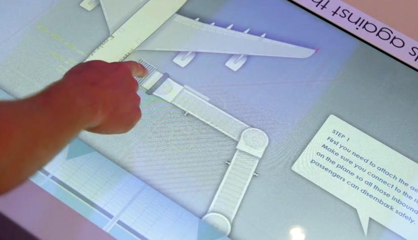 Permainan merakit pesawat dengan menggunakan layar sentuh.