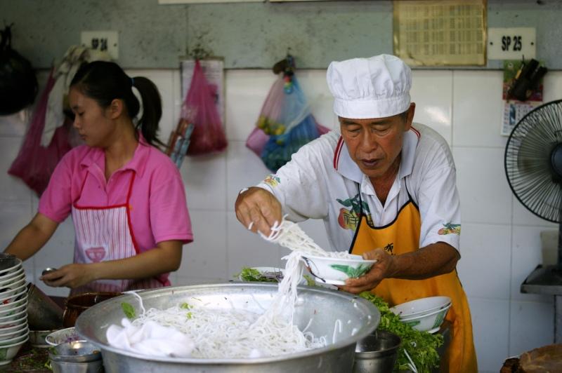 Penjual asam laksa di Pasar Air Itam. (Foto: Flickr/Akram)
