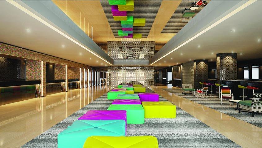 Lobi hotel memadukan warna-warna ceria dengan interior khas peranakan.