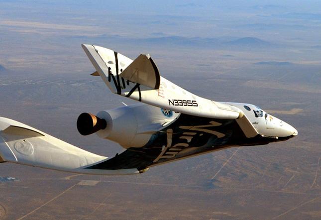 Pesawat Virgin Galactic yang akan membawa penumpangnya hingga ke lapisan terluar atmosfer. Foto: Luke Colby/Virgin Galactic.